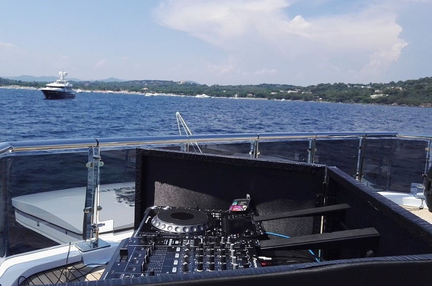 Simon DJ French Riviera installs his DJ equipment ready for a DJ Set on yacht moored off Saint Tropez