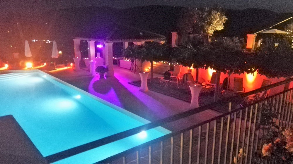 Luxury uplighting & party lighting installed around your pool & garden, anywhere from northern Italy to South West France